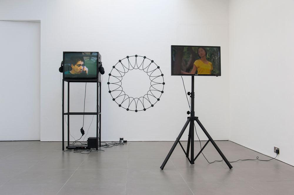 left: Michael Smith, Secret Horror, 1980, colour 4:3 video, duration 13 mins 24 secs, right: Tony Law, Strolling, 2012, single-channel video, duration 3 mins: 24 secs (looped), Cell Project Space