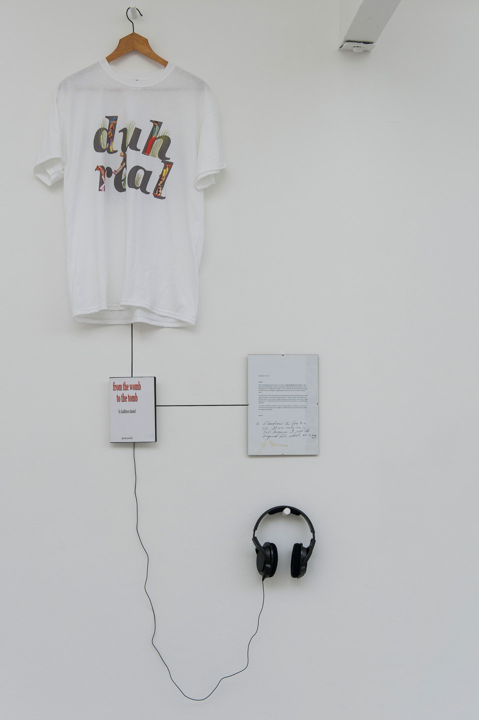 Kathleen Daniel, From the Womb to the Tomb, 2012, mp3 file, duration 51 mins 30 secs, digital print on DVD box cover, digital print on T-shirt, framed letter from the artist to the curator, Cell Project Space