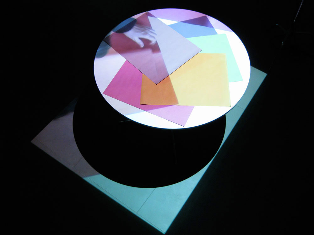 Kim Coleman & Jenny Hogarth 'Sugar Paper', 2008, looped digital film on dvd, table, sugar paper