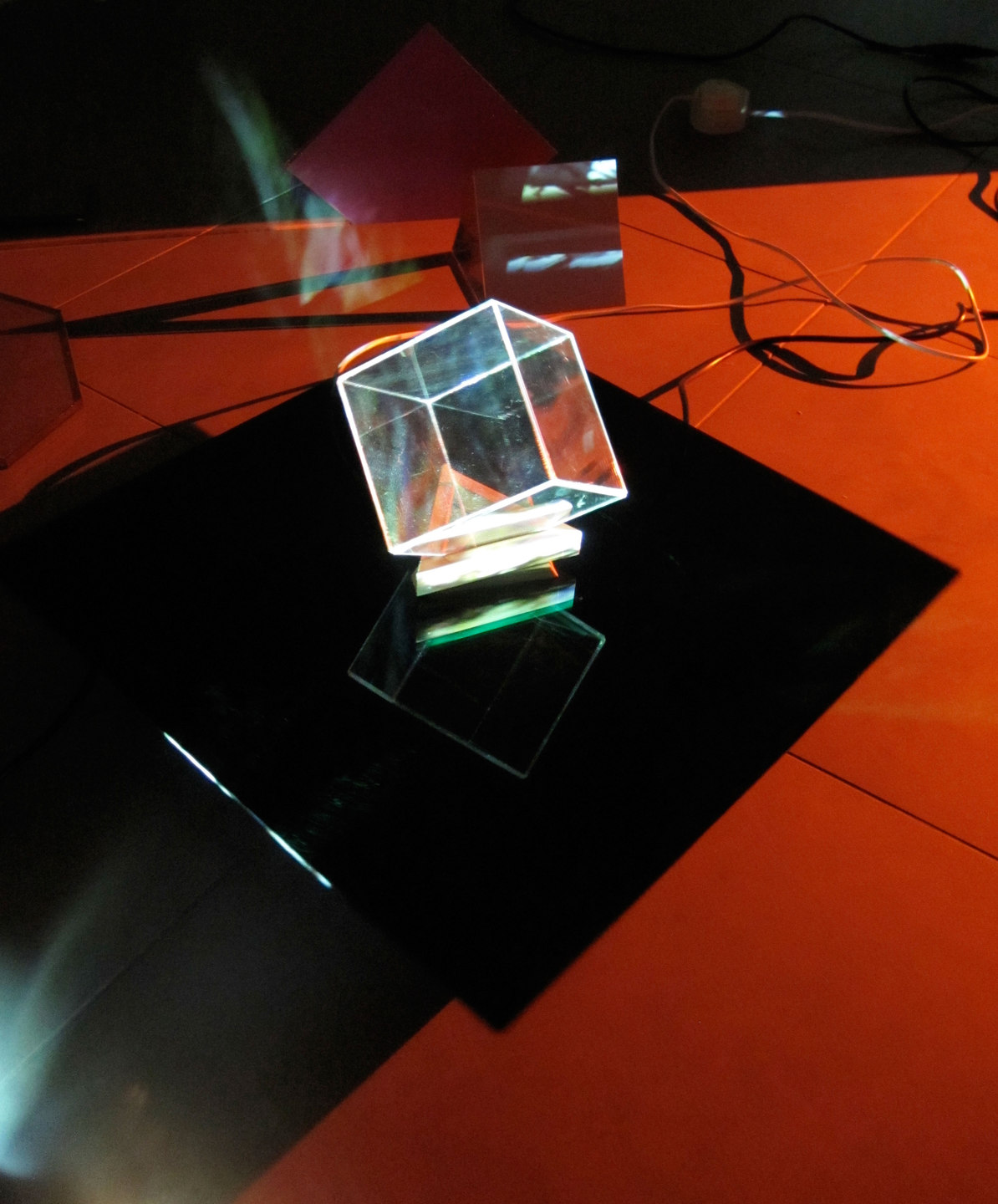 Laura Buckley, Extramundane 2010, Perspex, wood, mirror, motors, music lecterns, 3 video projections, audio (dimensions variable), Cell Project Space