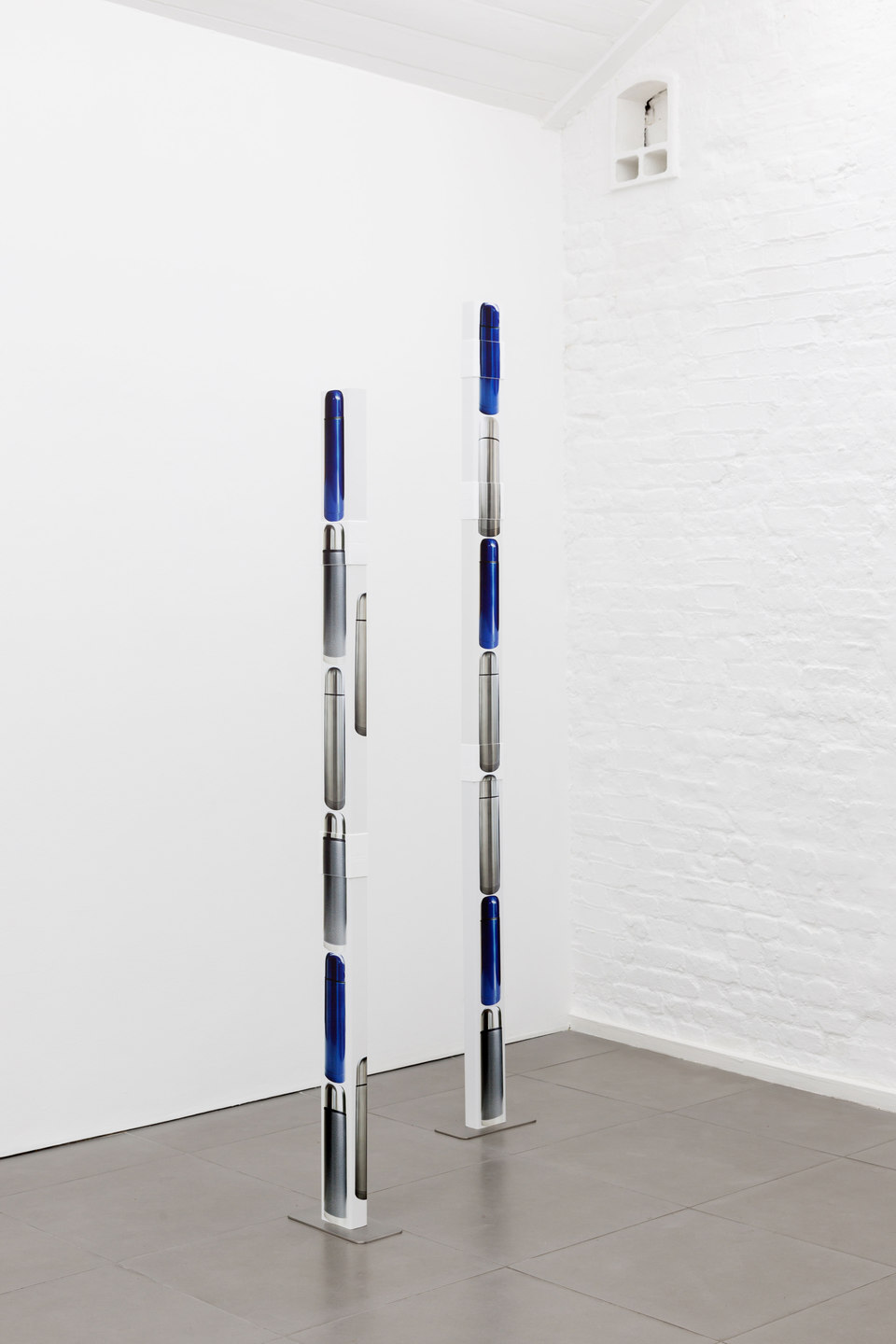Marte Eknæs, Reboot Horizon, 'Arranged for Effect (column) I', 2012, ventilation tubes with stickers, steel foot, Cell Project Space