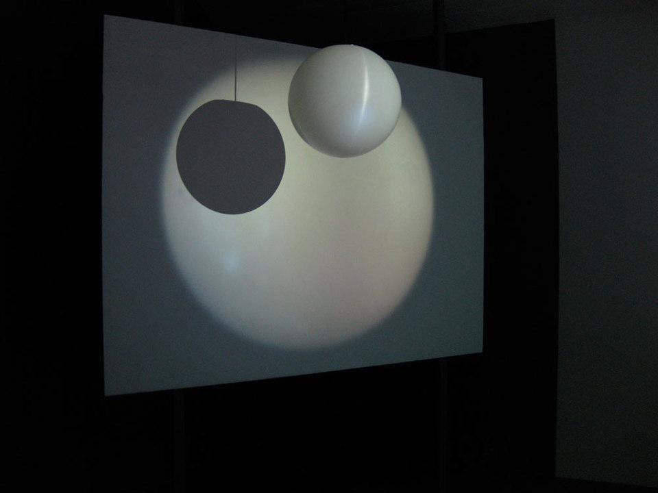 Kim Coleman & Jenny Hogarth 'Museum Light', 2008, looped digital film on dvd, globe pendant shape