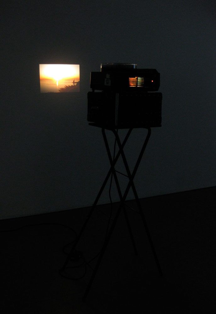 Richard T. Walker 'It's hard to find you because I can't quite see what you mean to me', 2009, slide projector, slides
