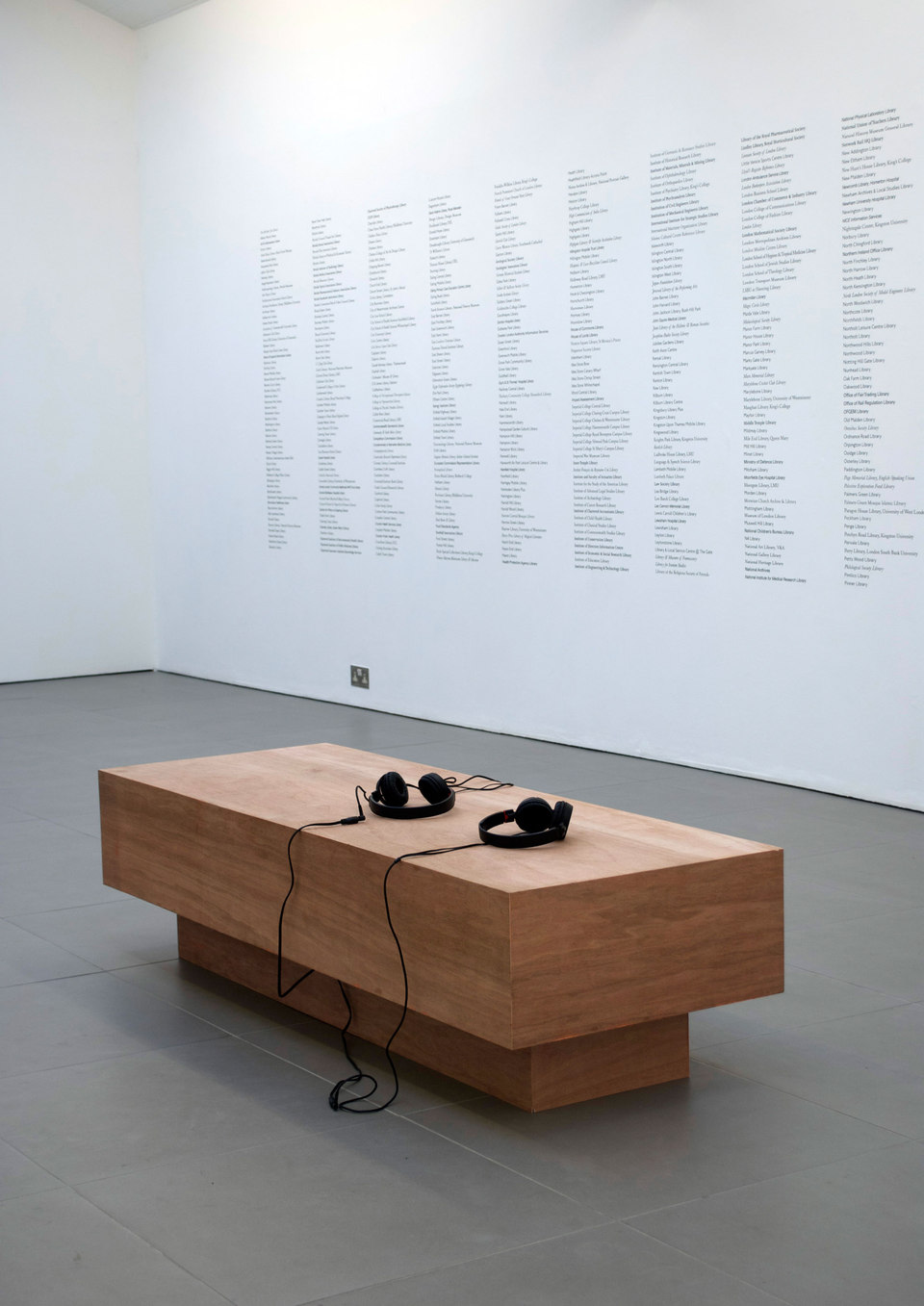 Ruth Beale, Now from Now, 2011, plywood, foam, fabric, headphones, audio on mp3, duration 9 min., library books from a selection of public libraries in london (58 x 160 cm), Cell Project Space